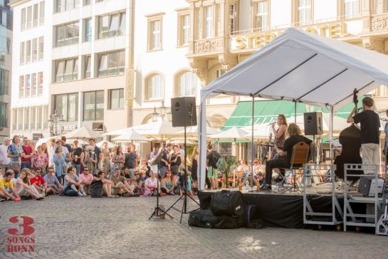 Enjoying the sun and the music at Marktplatz with Antiquariat